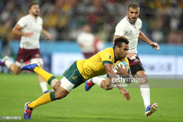 Will Genia of Australia scores his teams fourth try past Lasha Khmaladze of Georgia during the Rugby World Cup 2019 Group D game between Australia...