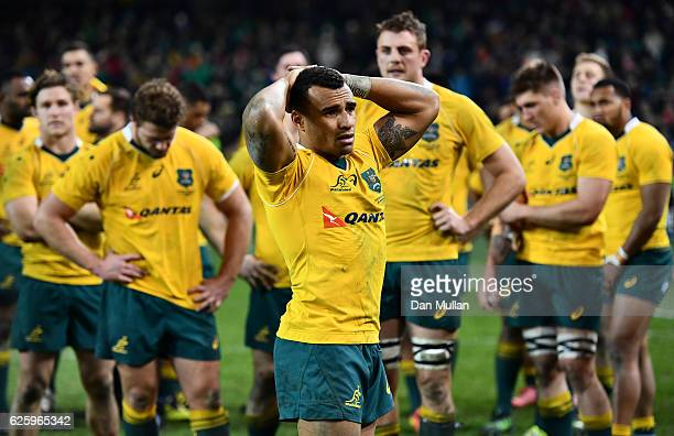 Will Genia of Australia stands dejected amongst his team mates following their defeat during the international match between Ireland and Australia at...