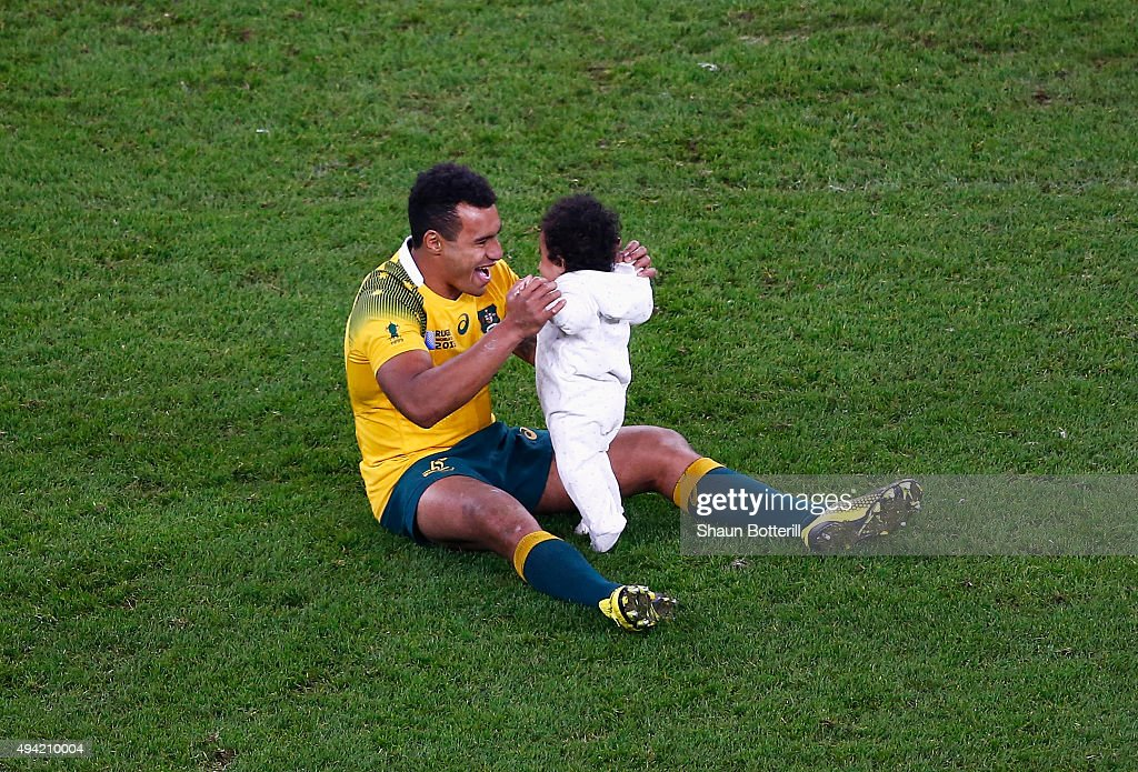 Will Genia of Australia walks on the field with his daughter Olivia during the 2015 Rugby World Cup Semi Final match between Argentina and Australia at Twickenham Stadium on October 25, 2015 in London, United Kingdom.