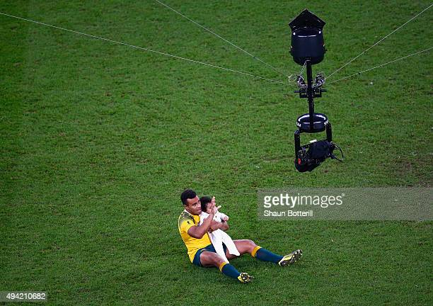 Will Genia of Australia walks on the field with his daughter Olivia during the 2015 Rugby World Cup Semi Final match between Argentina and Australia...