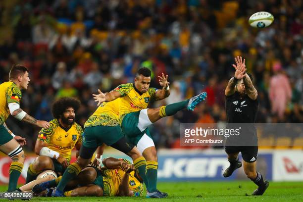 Will Genia of Australia's Wallabies kicks ahead as Rieko Ioane of New Zealand's All Blacks attempts to charge down during the Bledisloe Cup...