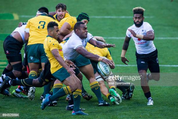 Will Genia of the Australian Wallabies Rugby Union Team kick is smothered by Leone Nakarawa of the Fijian Rugby Union Team during the International...