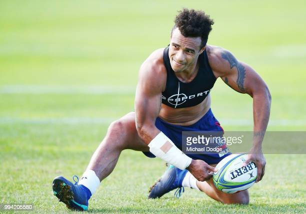 Will Genia of the Rebels wearing a cast on his injured arm passes the ball while taking part in his fitness test during a Melbourne Rebels Super...