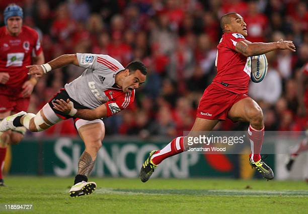 Will Genia of the Reds breaks away to score a try during the 2011 Super Rugby Grand Final match between the Reds and the Crusaders at Suncorp Stadium...