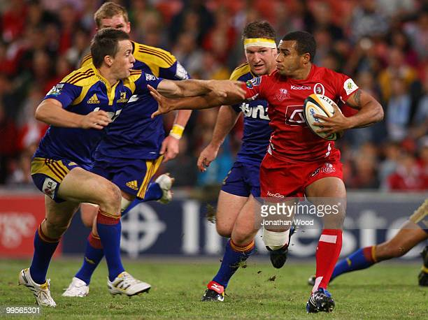 Will Genia of the Reds in attack during the round 14 Super 14 match between the Reds and the Highlanders at Suncorp Stadium on May 15, 2010 in...