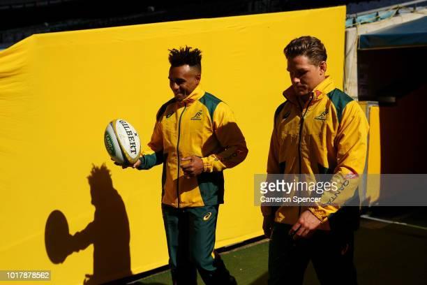 Will Genia of the Wallabies and Michael Hooper of the Wallabies walk onto the field during an Australian Wallabies captain's run at ANZ Stadium on...