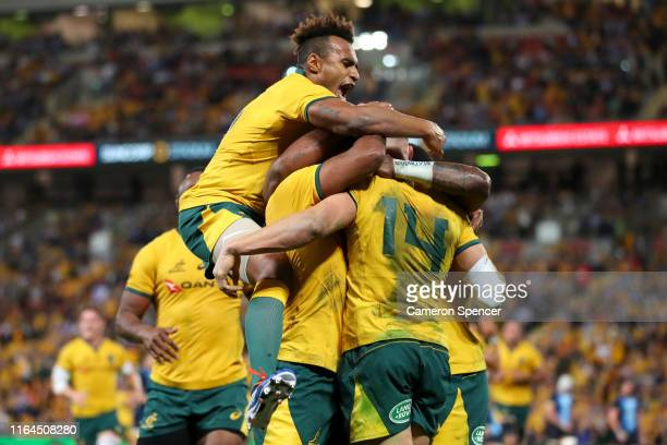 Will Genia of the Wallabies celebrates a try scored by team mate Reece Hodge of the Wallabies during the 2019 Rugby Championship Test Match between...