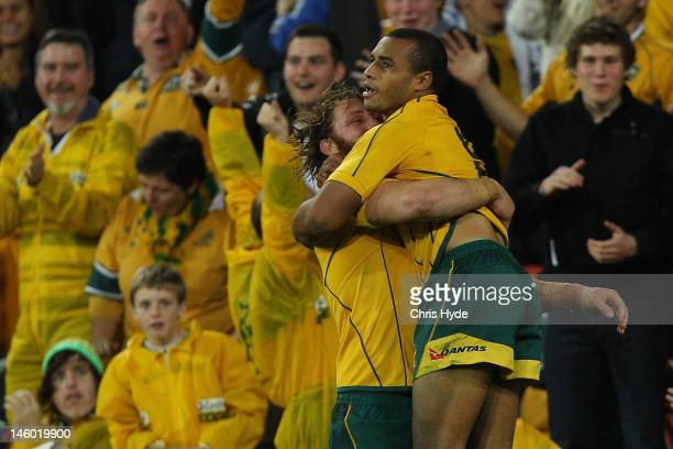 Will Genia of the Wallabies celebrates with team mate Scott Higginbotham after scoring a try during the international test match between the...