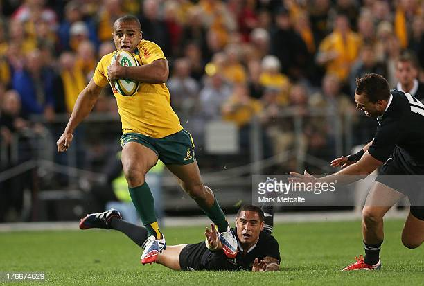Will Genia of the Wallabies evades the tackle of Aaron Smith of the All Blacks to score a try during The Rugby Championship Bledisloe Cup match...