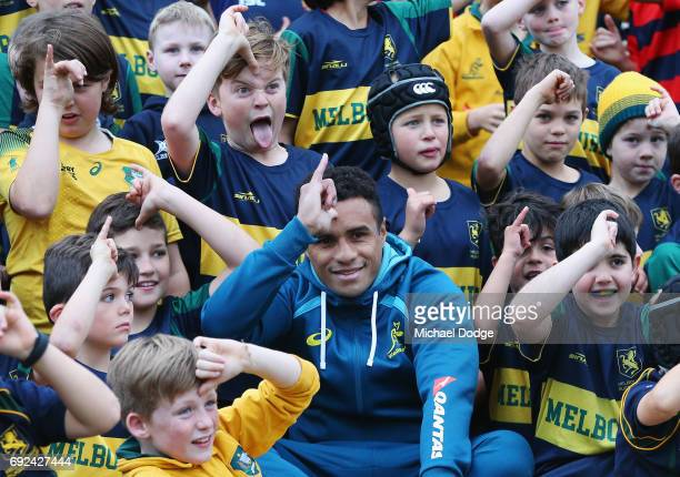 Will Genia of the Wallabies gesture while posing with fans during an Australian Wallabies training session at the Melbourne Rugby Union Football Club...