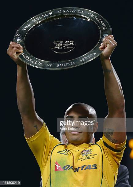 Will Genia of the Wallabies holds aloft the Nelson Mandela Challenge Plate after victory during Rugby Championship match between the Australian...