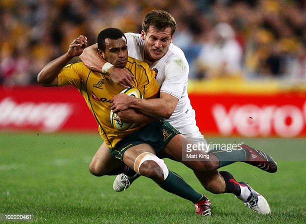 Will Genia of the Wallabies is tackled by Mark Cueto of England during the Cook Cup Test Match between the Australian Wallabies and England at ANZ...