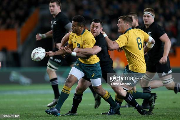 Will Genia of the Wallabies passes the ball during The Rugby Championship Bledisloe Cup match between the New Zealand All Blacks and the Australia...
