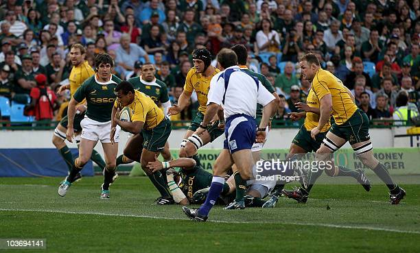 Will Genia of the Wallabies races clear to score the first try during the 2010 TriNations match between the South African Springboks and the...