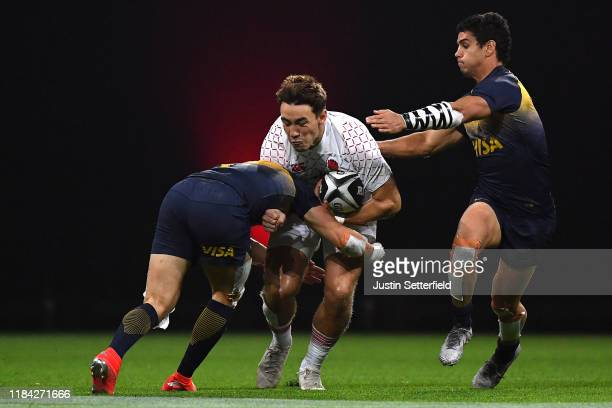 Will Glover of England is tackled by Francisco Ulloa of Argentina and Lautaro Bazan Velez of Argentina during the Rugby X at The O2 Arena on October...