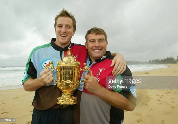 Will Greenwood and Jason Leonard of Harlequins hold the William Webb Ellis Trophy wearing their Zurich Premiership shirts pose on November 24 2003 in...