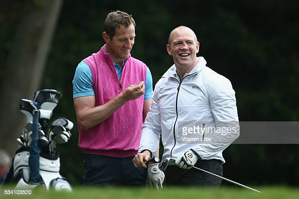 Will Greenwood and Mike Tindall react during the ProAm prior to the BMW PGA Championship at Wentworth on May 25 2016 in Virginia Water England