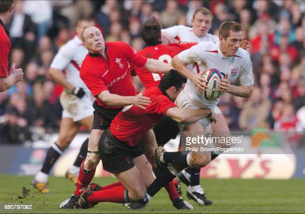 Will Greenwood of England is tackled during the RBS Six Nations match between England and Wales at Twickenham Stadium in London on the 20th March 2004