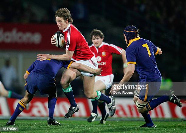 Will Greenwood of the Lions is tackled by Otago's Nick Evans during the match between Otago and the British and Irish Lions at Carisbrook on June 18,...
