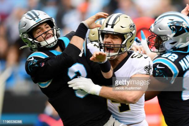 Will Grier of the Carolina Panthers is hit after a throw by Kiko Alonso of the New Orleans Saints during the first quarter during their game at Bank...
