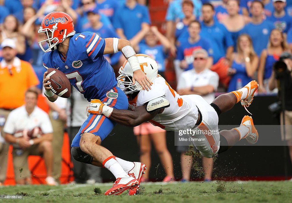 Will Grier #7 of the Florida Gators escapes a tckle from Owen Williams #58 of the Tennessee Volunteers during a game at Ben Hill Griffin Stadium on September 26, 2015 in Gainesville, Florida.