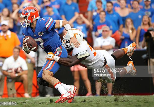 Will Grier of the Florida Gators escapes a tckle from Owen Williams of the Tennessee Volunteers during a game at Ben Hill Griffin Stadium on...