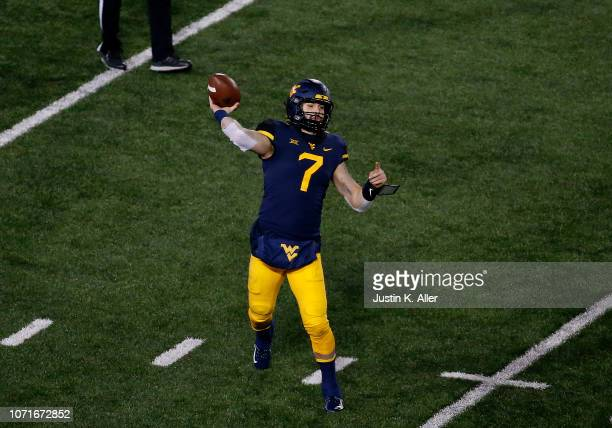 Will Grier of the West Virginia Mountaineers in action against the Oklahoma Soonersrs on November 23 2018 at Mountaineer Field in Morgantown West...