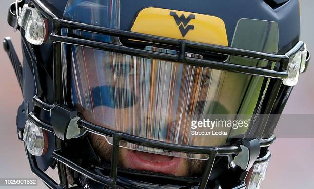 Will Grier of the West Virginia Mountaineers warms up before their game against the Tennessee Volunteers at Bank of America Stadium on September 1...