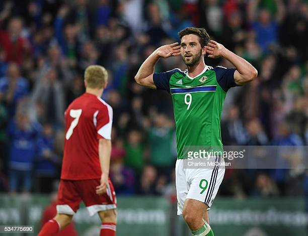 Will Grigg of Northern Ireland celebrates after scoring during the international friendly game between Northern Ireland and Belarus on May 27 2016 in...