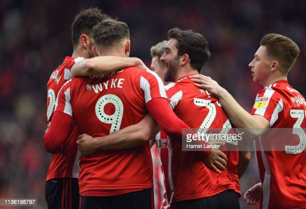 Will Grigg of Sunderland celebrates with teammates after scoring his team's second goal during the Sky Bet League One match between Sunderland and...