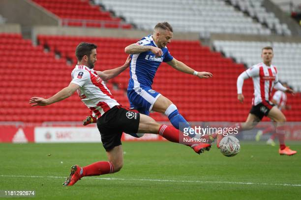 Will Grigg of Sunderland in action with Mark Byrne of Gillingham during the FA Cup match between Sunderland and Gillingham at the Stadium Of Light...