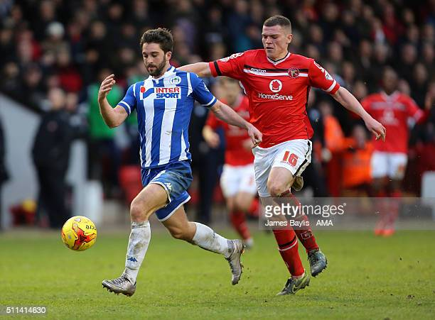 Will Grigg of Wigan Athletic and Matt Preston of Walsall during the Sky Bet League One match between Walsall and Wigan Athletic at Bescot Stadium on...