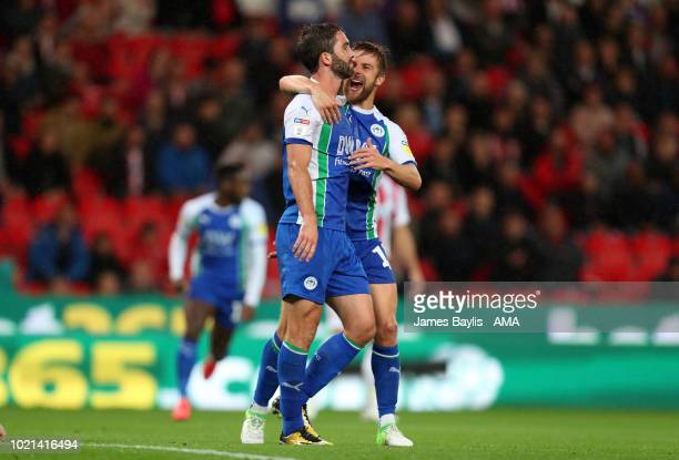 Will Grigg of Wigan Athletic celebrates after scoring a goal to make it 01 during the Sky Bet Championship match between Stoke City and Wigan...