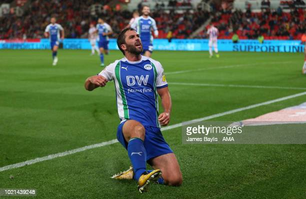 Will Grigg of Wigan Athletic celebrates after scoring a goal to make it 03 during the Sky Bet Championship match between Stoke City and Wigan...