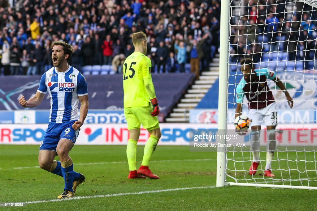 Will Grigg of Wigan Athletic celebrates after scoring a goal to make it 2-0 during the The Emirates FA Cup Fourth Round match between Wigan Athletic and West Ham United on January 27, 2018 in Wigan, United Kingdom.