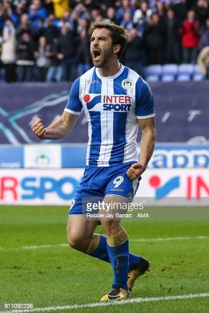 Will Grigg of Wigan Athletic celebrates after scoring a goal to make it 20 during the The Emirates FA Cup Fourth Round match between Wigan Athletic...