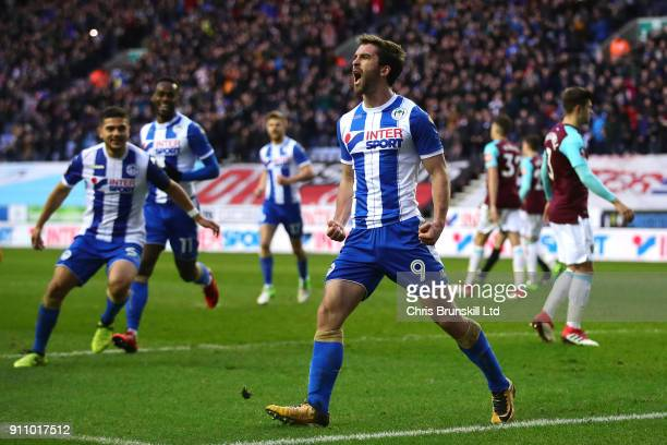 Will Grigg of Wigan Athletic celebrates scoring his side's second goal during the Emirates FA Cup Fourth Round match between Wigan Athletic and West...