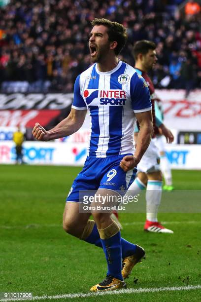 Will Grigg of Wigan Athletic celebrates scoring his side's second goal from the penalty spot during the Emirates FA Cup Fourth Round match between...