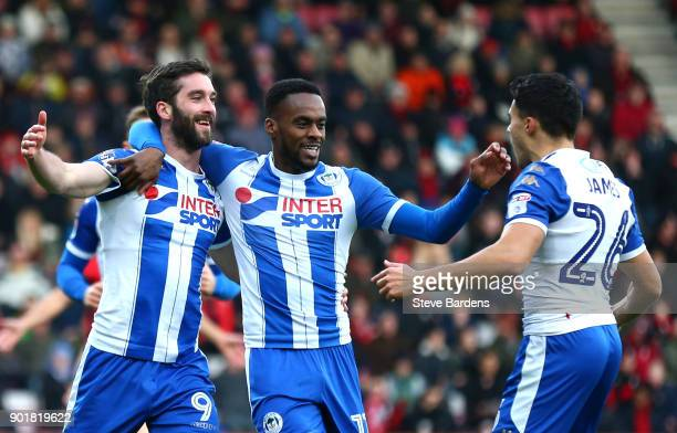 Will Grigg of Wigan Athletic celebrates scoring the opening goal with Gavin Massey and Reece James of Wigan Athletic during the The Emirates FA Cup...