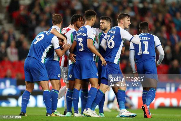 Will Grigg of Wigan Athletic celebrates with his team mates after scoring a goal to make it 01 during the Sky Bet Championship match between Stoke...
