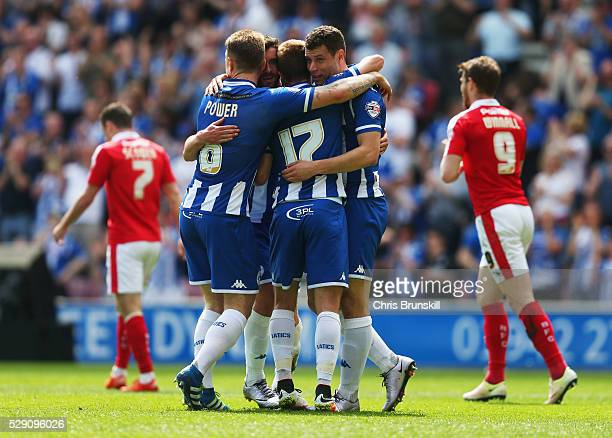 Will Grigg of Wigan Athletic celebrates with team mates as he scores their first goal during the Sky Bet League One match between Wigan Athletic and...