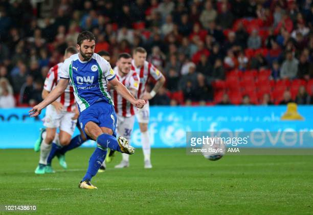 Will Grigg of Wigan Athletic scores a goal to make it 03 during the Sky Bet Championship match between Stoke City and Wigan Athletic at Bet365...