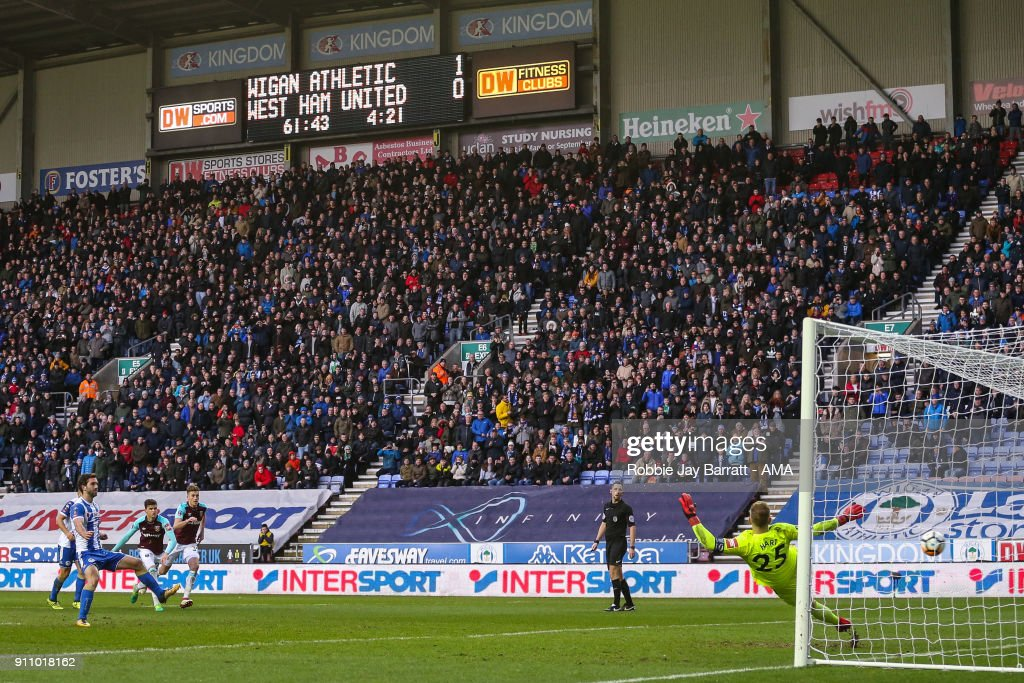 Will Grigg of Wigan Athletic scores a goal to make it 2-0 during the The Emirates FA Cup Fourth Round match between Wigan Athletic and West Ham United on January 27, 2018 in Wigan, United Kingdom.