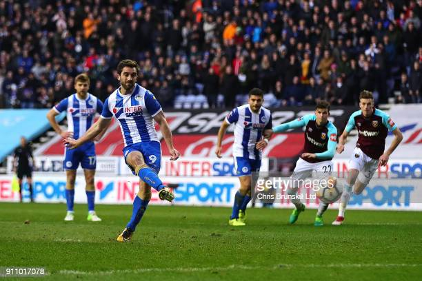 Will Grigg of Wigan Athletic scores his side's second goal from the penalty spot during the Emirates FA Cup Fourth Round match between Wigan Athletic...