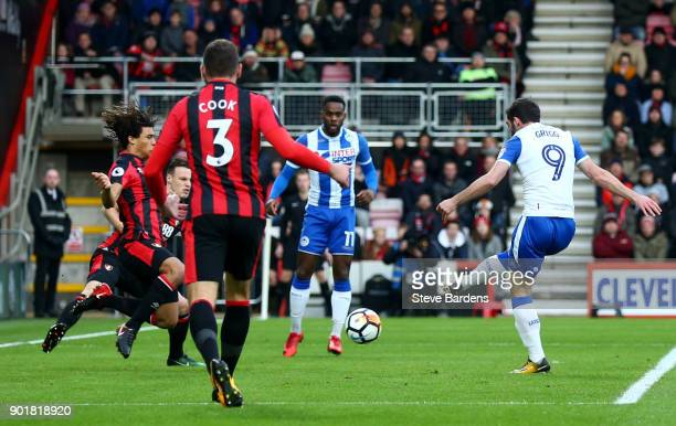 Will Grigg of Wigan Athletic scores the opening goal during the The Emirates FA Cup Third Round match between AFC Bournemouth and Wigan Athletic at...