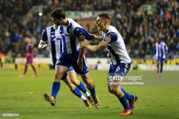 Will Grigg of Wigan celebrates with teammate Max Power of Wigan after scoring their 1st goal during The Emirates FA Cup Fifth Round match between...