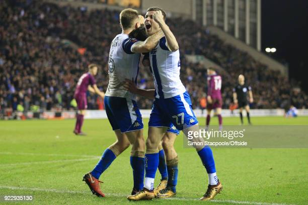 Will Grigg of Wigan celebrates with teammate Ryan Colclough of Wigan after scoring their 1st goal during The Emirates FA Cup Fifth Round match...