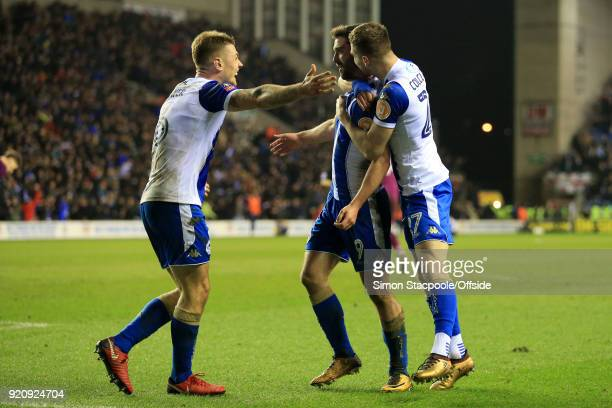 Will Grigg of Wigan celebrates with teammates Max Power of Wigan and Ryan Colclough of Wigan after scoring their 1st goal during The Emirates FA Cup...
