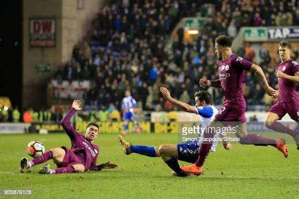 Will Grigg of Wigan scores their 1st goal during The Emirates FA Cup Fifth Round match between Wigan Athletic and Manchester City at the DW Stadium...