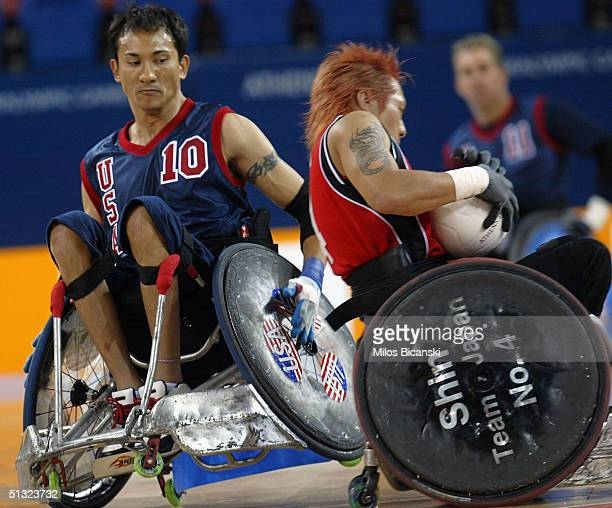 Will Groulx of USA tries to stop Shimakawa Shinichi of Japan during the Wheelchair Rugby mach between USA and Japan at the Athens 2004 Paralympic...